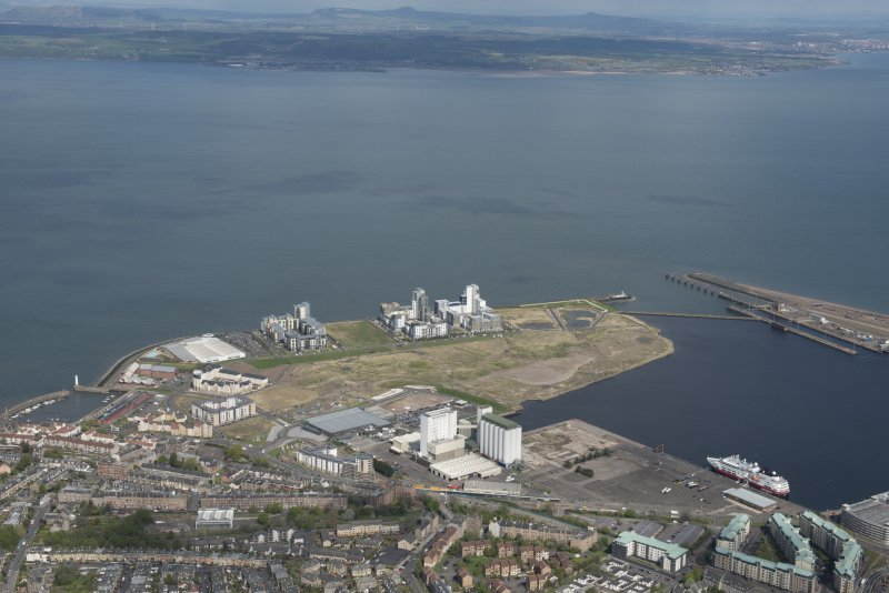 General oblique aerial view of Leith Docks centred on the Caledonia Flour Mills, looking to the N.