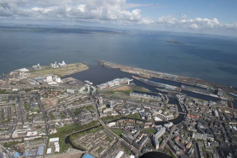 General oblique aerial view of Leith Docks centred on the Caledonia Flour Mills, looking to the NE.