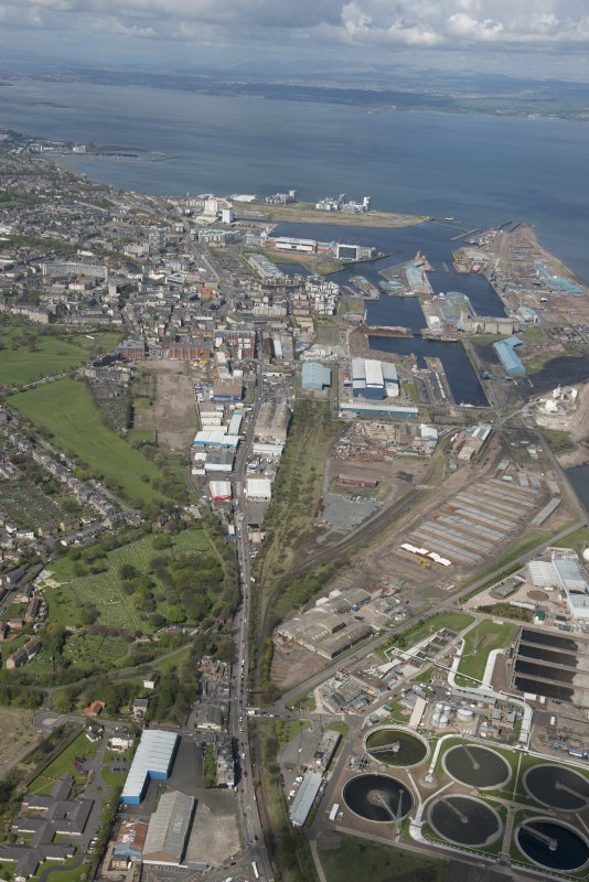General oblique aerial view of Leith Docks centred on the Western Harbour, looking to the WNW.