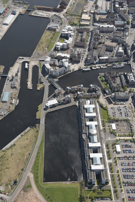 General oblique aerial view of Leith Docks centred on Victoria Docks, looking to the SE.