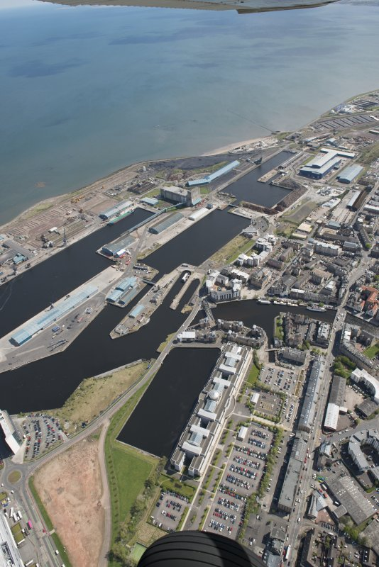 General oblique aerial view of Leith Docks centred on Victoria Docks, looking to the E.