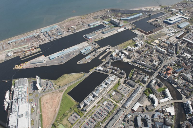 General oblique aerial view of Leith Docks centred on Victoria Docks, looking to the NE.
