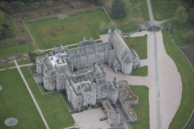 Oblique aerial view of Dunecht House and chapel, looking to the WNW.