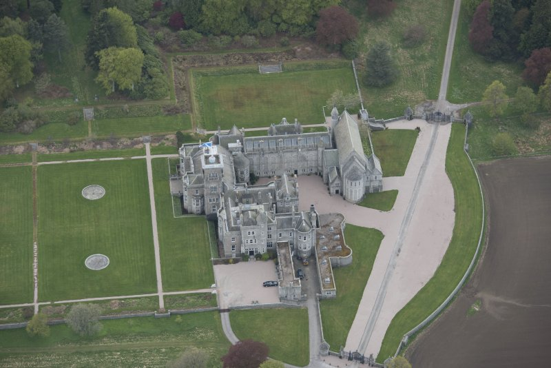 Oblique aerial view of Dunecht House adjacent chapel, looking to the W.