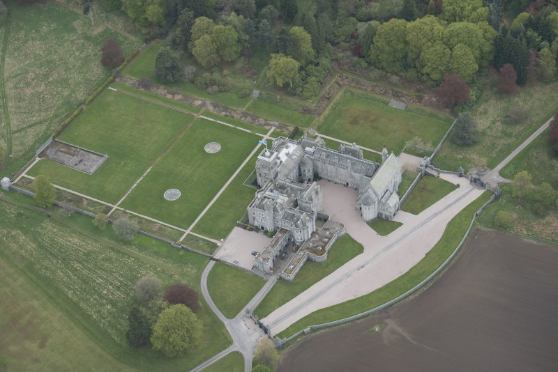 Oblique aerial view of Dunecht House and chapel, looking to the SW.