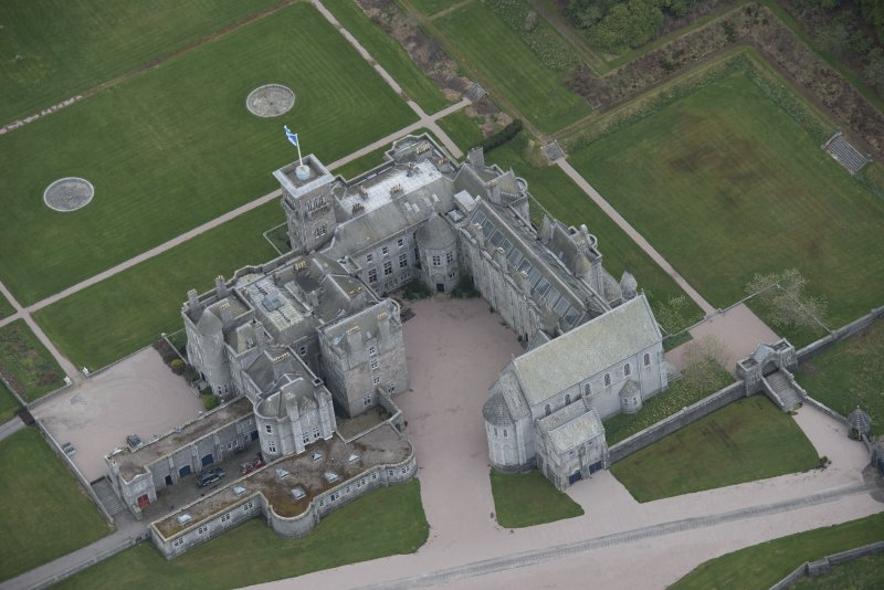 Oblique aerial view of Dunecht House and chapel, looking to the SSW.