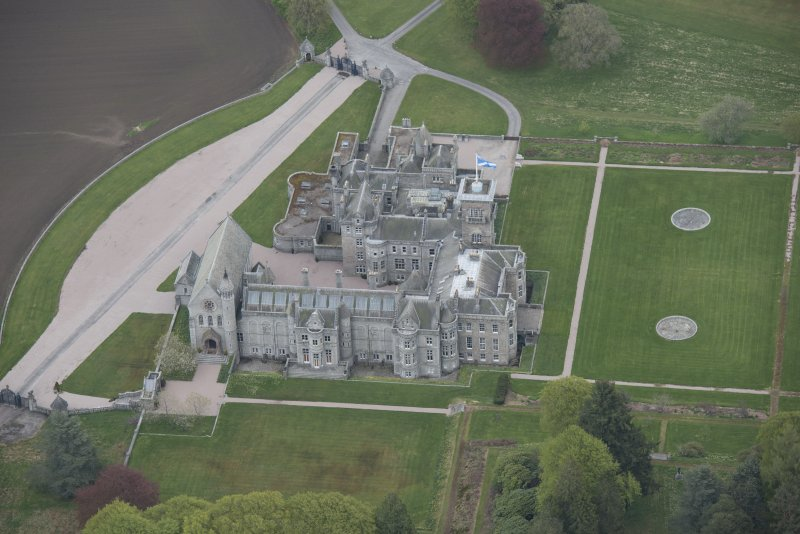 Oblique aerial view of Dunecht House and chapel, looking to the ENE.