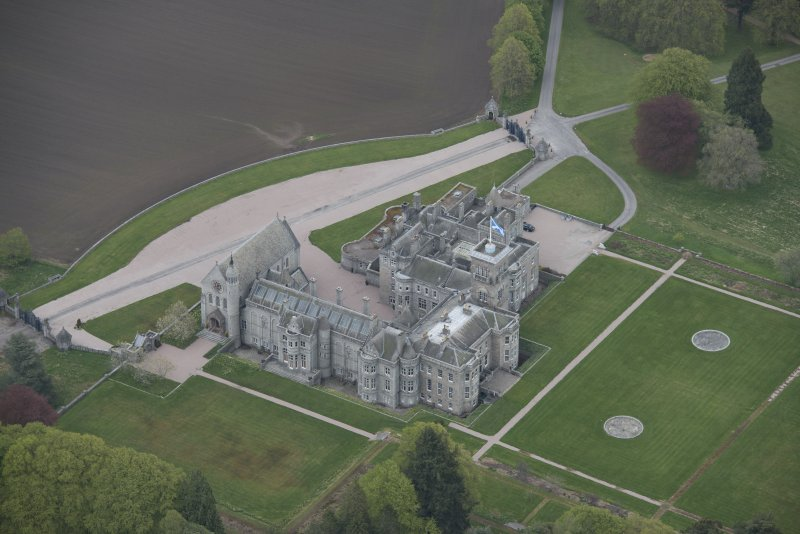 Oblique aerial view of Dunecht House and chapel, looking to the NE.