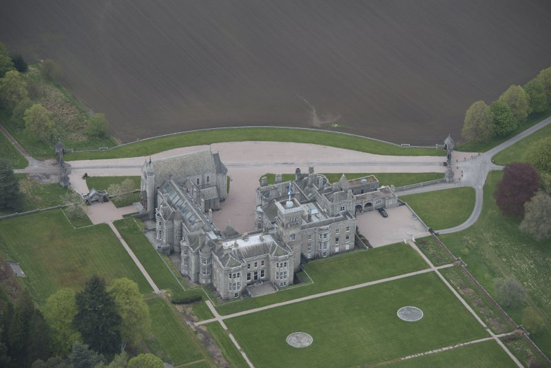 Oblique aerial view of Dunecht House and chapel, looking to the NNE.