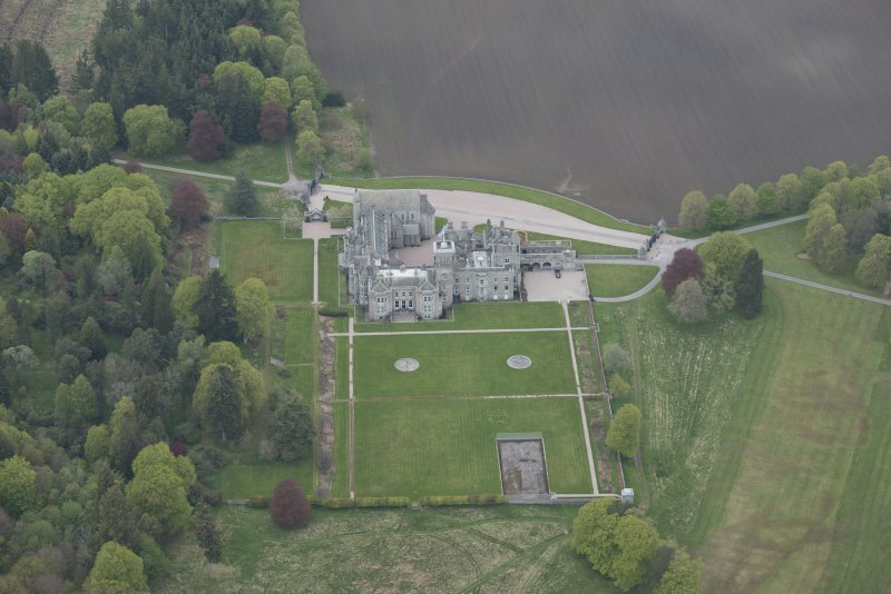 Oblique aerial view of Dunecht House and chapel, looking to the N.