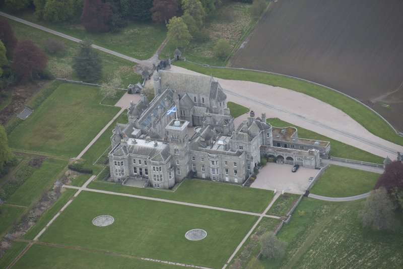 Oblique aerial view of Dunecht House and chapel, looking to the NNW.