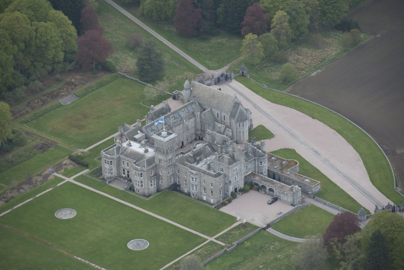 Oblique aerial view of Dunecht House and chapel, looking to the NW.