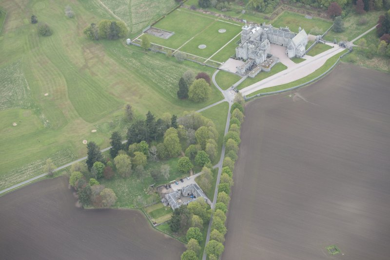 General oblique aerial view of Dunecht House, chapel and stable blocks, looking to the SW.