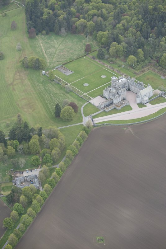 General oblique aerial view of Dunecht House, chapel and stable blocks, looking to the S.
