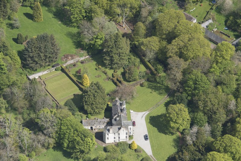 Oblique aerial view of Corsindae House with adjacent walled garden, looking to the E.