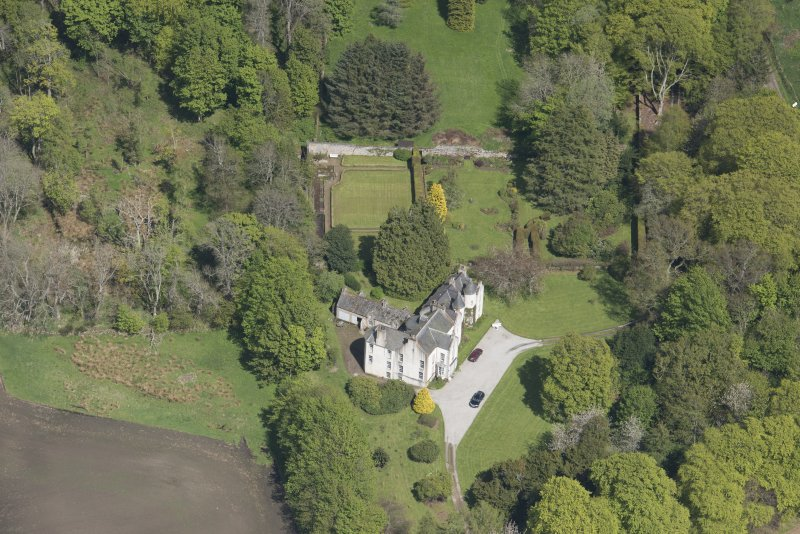 Oblique aerial view of Corsindae House with adjacent walled garden, looking to the ENE.