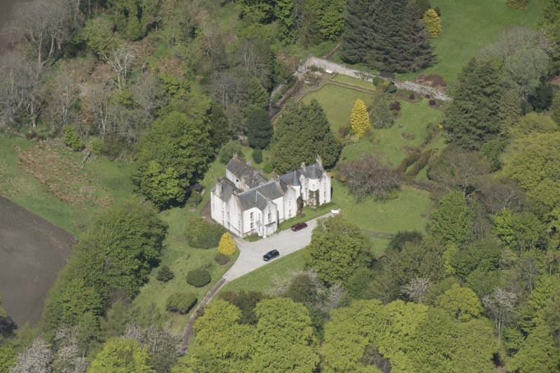 Oblique aerial view of Corsindae House with adjacent walled garden, looking to the NNE.