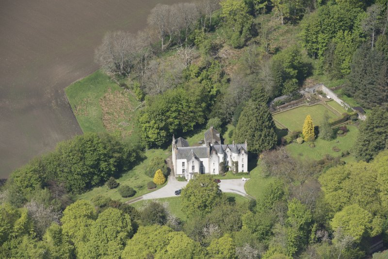 Oblique aerial view of Corsindae House with adjacent walled garden, looking to the N.