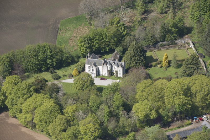 Oblique aerial view of Corsindae House with adjacent walled garden, looking to the NNW.