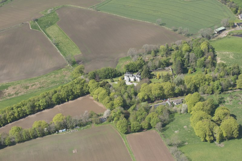 General oblique aerial view of Corsindae House with adjacent walled garden, looking to the NNW.
