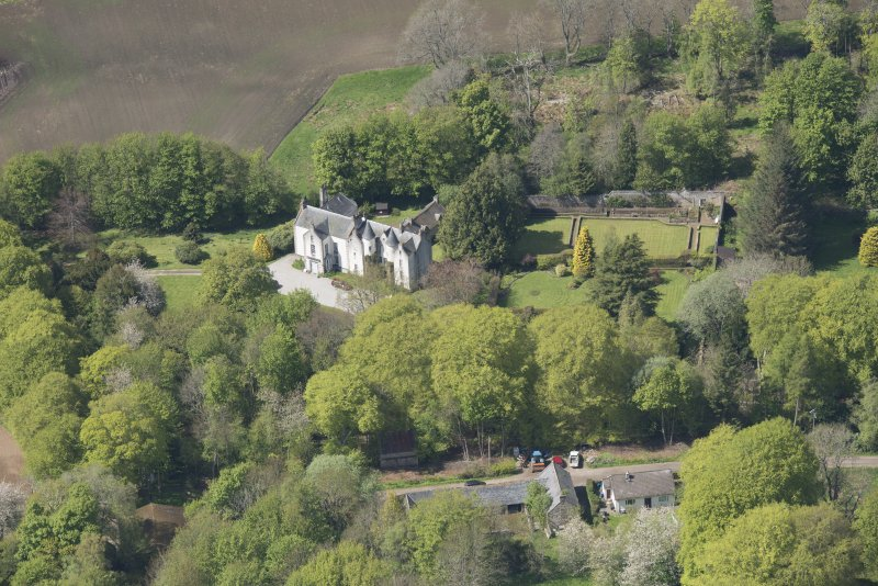 Oblique aerial view of Corsindae House with adjacent walled garden, looking to the NW.