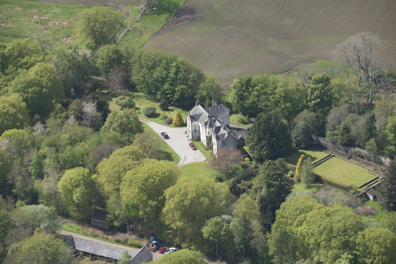 Oblique aerial view of Corsindae House with adjacent walled garden, looking to the WNW.
