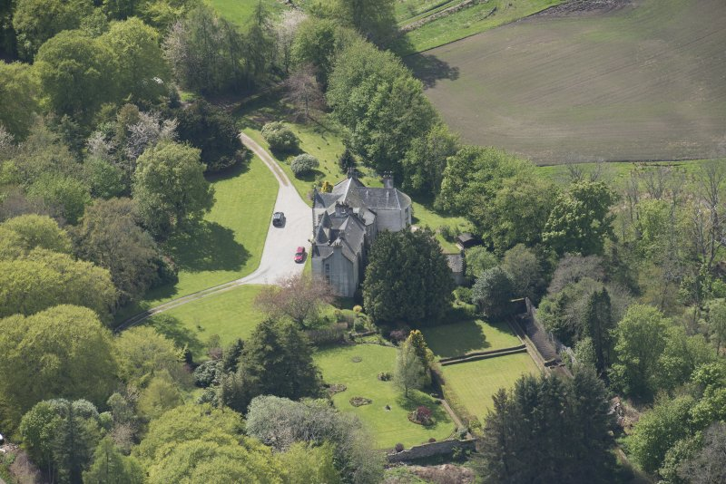 Oblique aerial view of Corsindae House with adjacent walled garden, looking to the W.