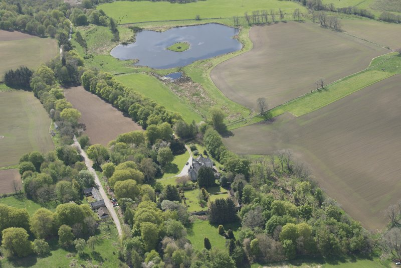 General oblique aerial view of Corsindae House with adjacent walled garden, looking to the WSW.