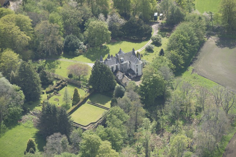 Oblique aerial view of Corsindae House with adjacent walled garden, looking to the SSW.