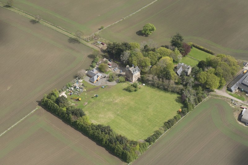 Oblique aerial view of Tillycairn House, looking to the E.