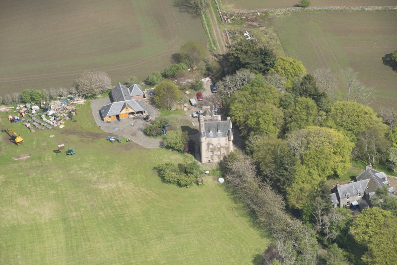 Oblique aerial view of Tillycairn House, looking to the ENE.