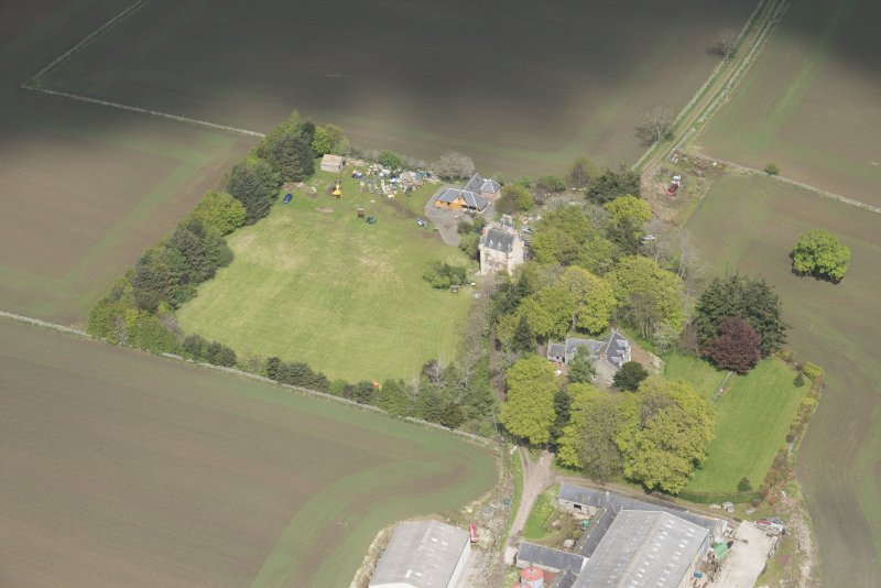 Oblique aerial view of Tillycairn House, looking to the NNE.