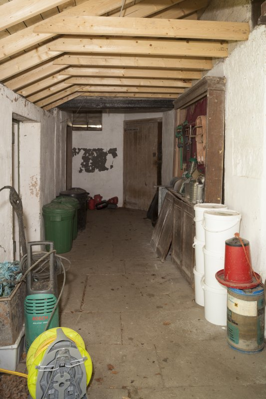 Interior. General view of corridor behind the stables in the West wing.