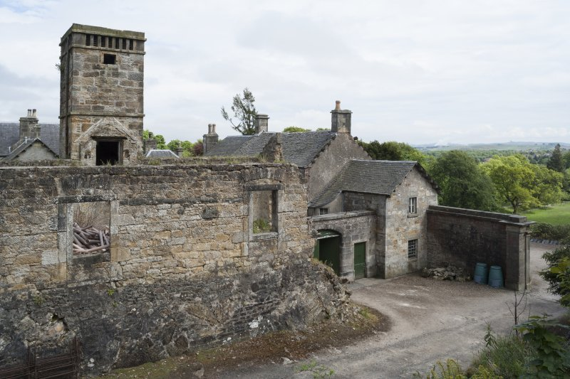 General view of West wing from West showing ruin and old clock tower.