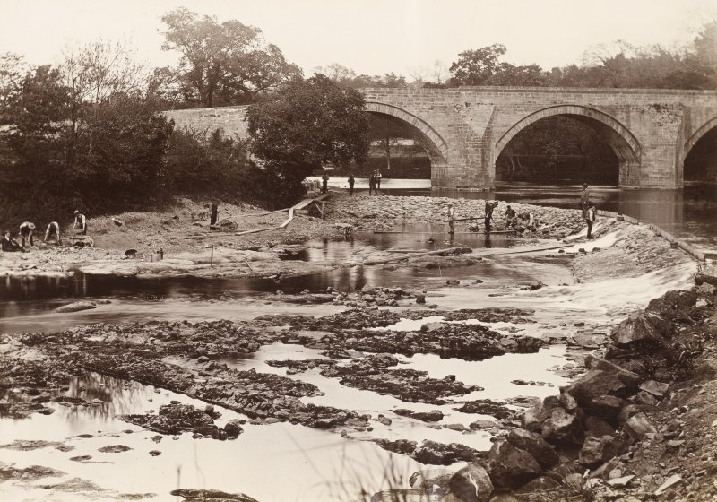 Stair Bridge from south east. Weir under reconstruction taken from lade intake for Water of Ayr Hone Works, Dalmore Mill. From family album of Mr K Montgomerie. Survey of Private Collection