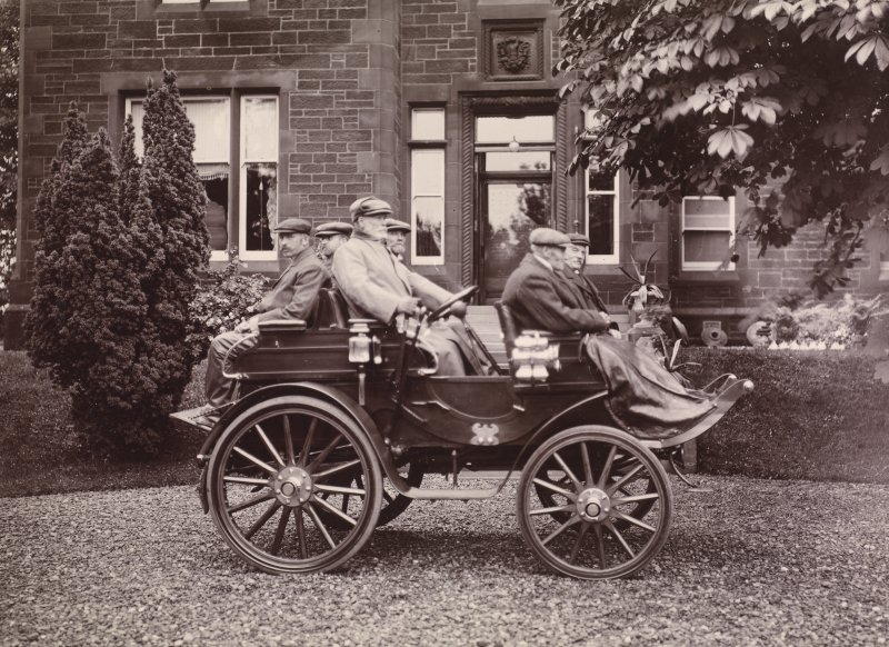 Dalmore House, six seater dog cart style Arrol Johnston car (10hp, wooden body, manufactured either in Camlachie, Glasgow  (pre-1901), or Paisley, Renfrewshire). From family album of Mr K Montgomerie. Survey of Private Collection