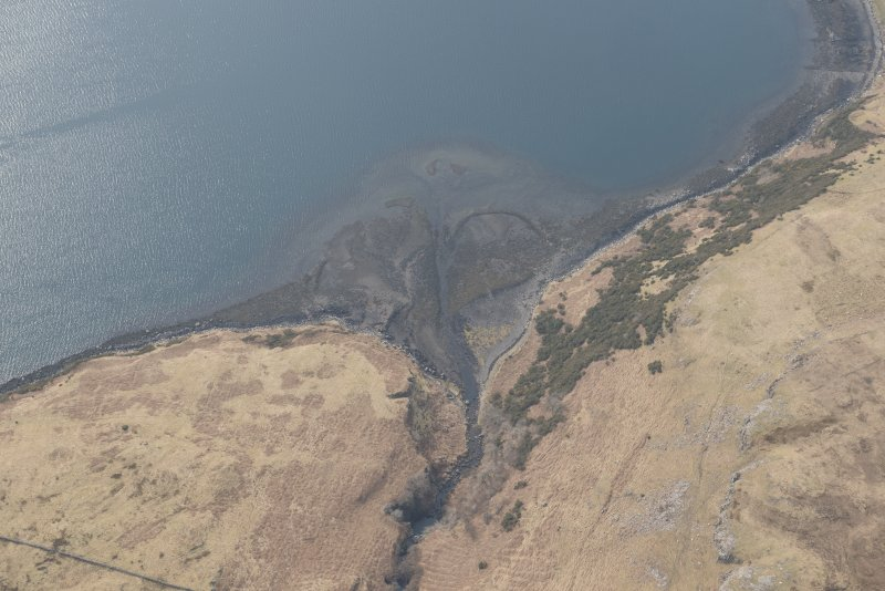 Oblique aerial view of the fish trap at Loch Harport, looking SW.