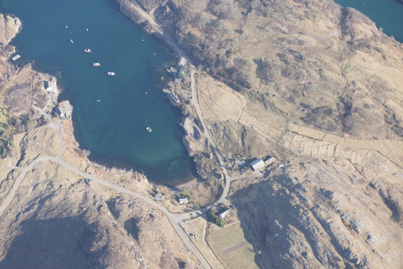 Oblique aerial view of Ardleshaig centred on the remains of the fish trap, looking N.