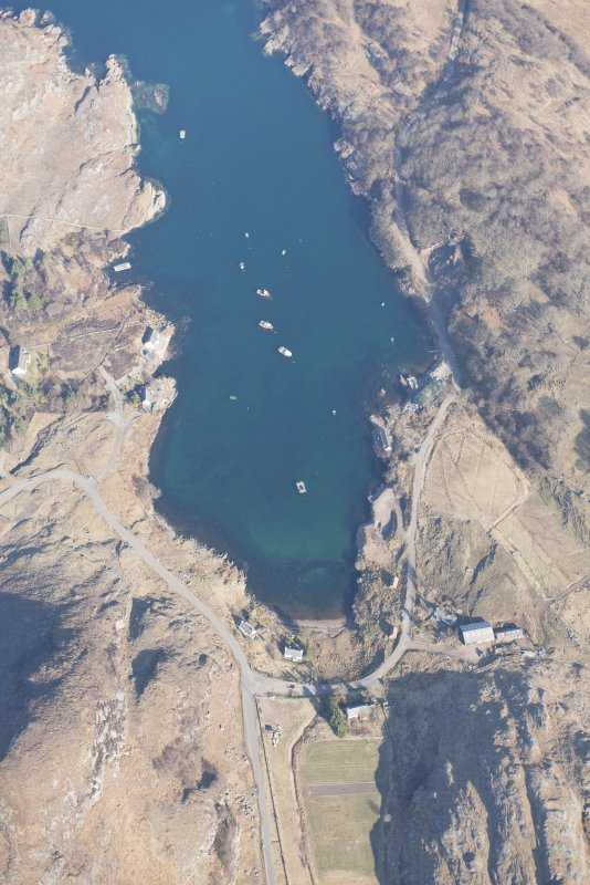 Oblique aerial view of Ardleshaig centred on the remains of the fish trap, looking NNW.