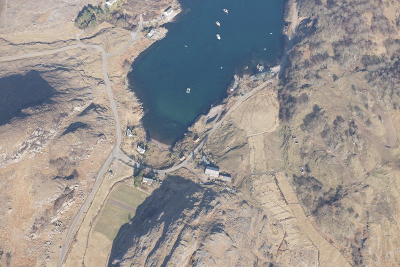 Oblique aerial view of Ardleshaig centred on the remains of the fish trap, looking NW.