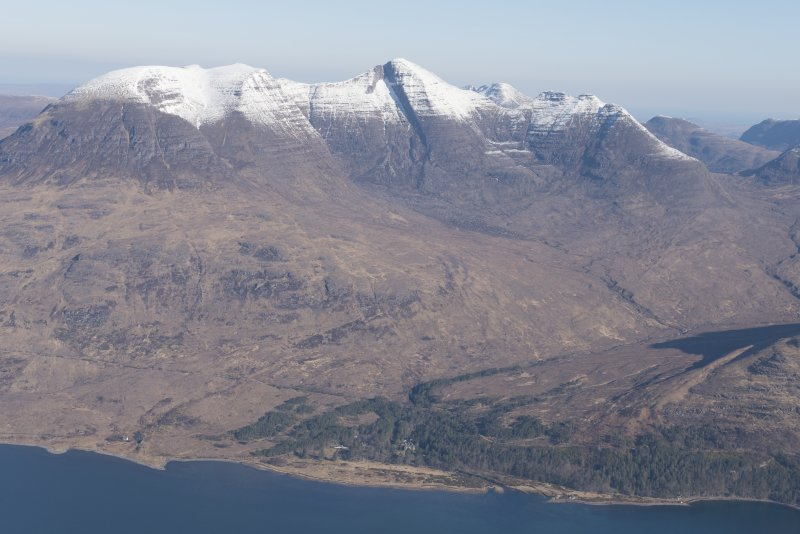 General oblique aerial view of Beinn Alligin with Torridon House in the foreground, looking NNW.