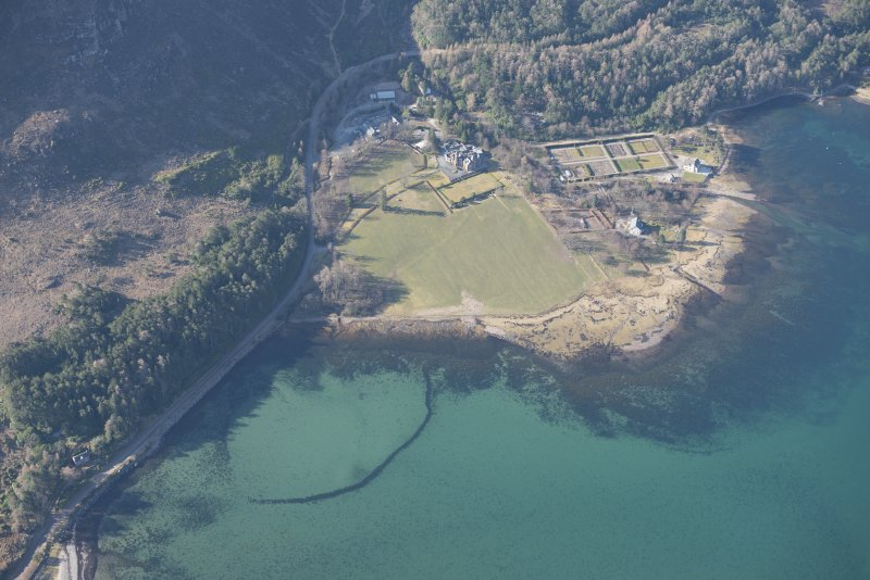 Oblique aerial view of the fish trap and Loch Torridon Hotel, looking SSW.