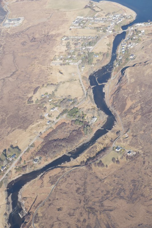 Oblique aerial view of the weirs along the River Ewe, looking NW.