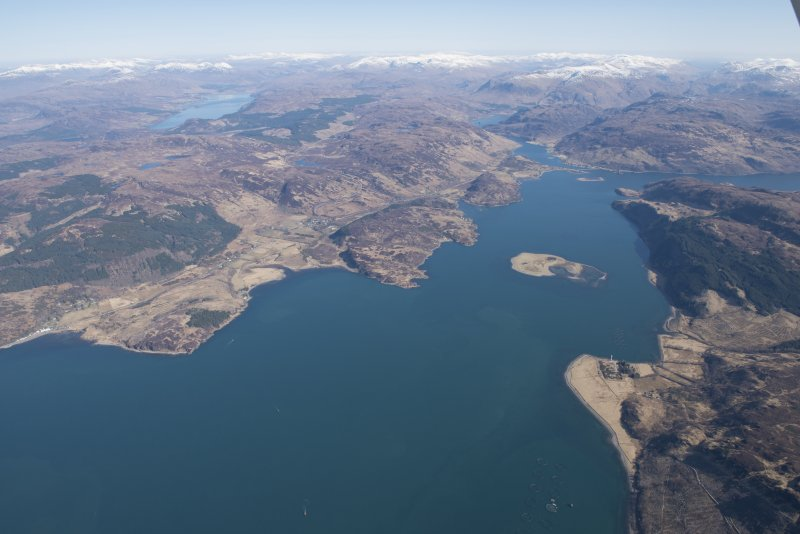 General oblique aerial view of Loch Alsh centred on Glas Eilean with Eilean Donan in the distance, looking ENE.