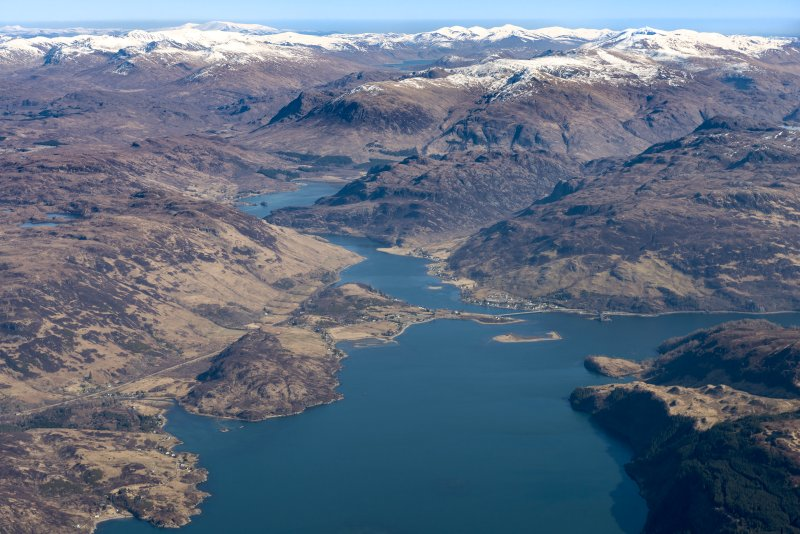 General oblique aerial view of Loch Alsh with Eilean Donan in the distance, looking E.