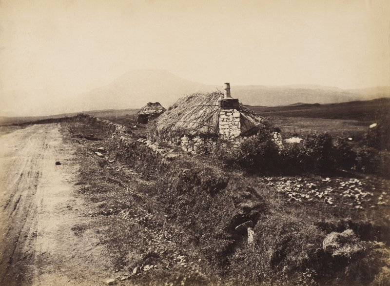 View of unidentified cottages and garden at Dunvegan