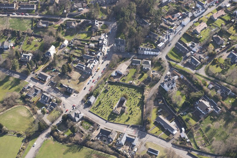 Oblique aerial view of Stow centred on Old Stow Kirk, looking ENE.