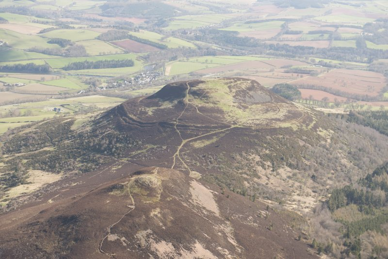 Oblique aerial view of the Eildon Hills, looking NE.