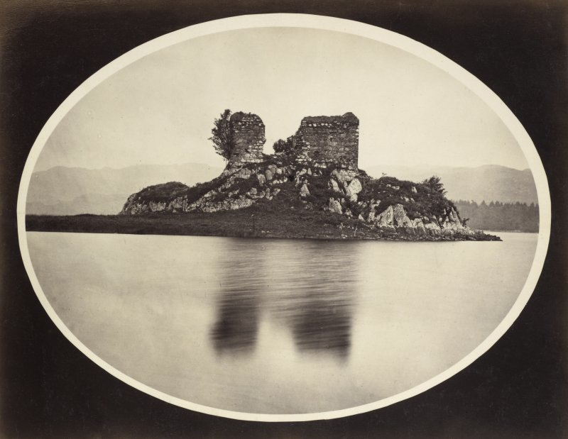 View of the late medieval Fincharn Castle on a promontory near the south end of Loch Awe with the view of its eastern shore in the foreground, Lochawe, Kilmichael Glassary. Vignetted Image Titled: '164. Fincharn Castle.' PHOTOGRAPH ALBUM NO 186: J B MACKENZIE ALBUMS vol.1