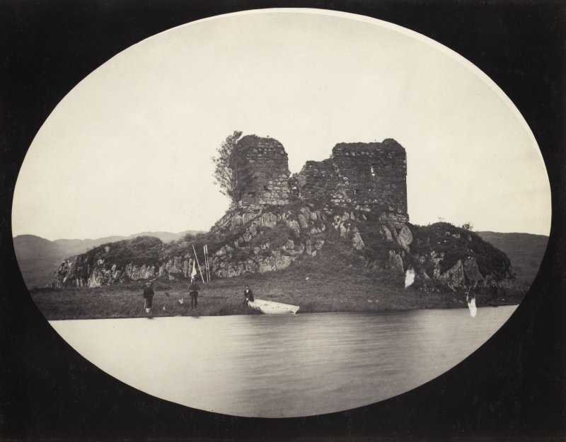 View of the late medieval Fincharn Castle with three boating men in the foreground, situated on the promontory near the south end of Loch Awe with the view of its eastern shore in the foreground, Lochawe, Kilmichael Glassary. Vignetted Image. Titled: '165. Fincharn Castle, Lochawe.' PHOTOGRAPH ALBUM NO 186: J B MACKENZIE ALBUMS vol.1